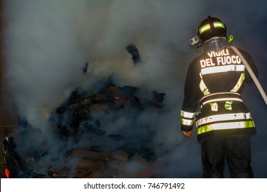 firefighter with protective helmet and the word VIGILI DEL FUOCO meaning Firefighters in Italian