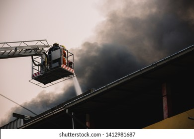 Firefighter rescue working from burning building  in fire and smoke  incident.