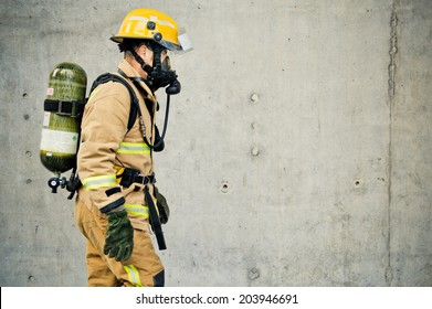 Firefighter running with all their gear