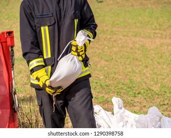 firefighter with sandbag