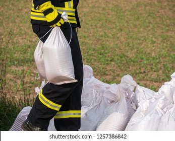 Firefighter with sandbags