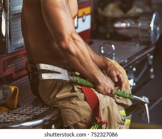 Firefighter sitting with axe