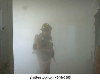 Firefighter in smoke filled room