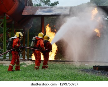 firefighter spray water to fire buring training
