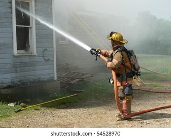 firefighter spraying water