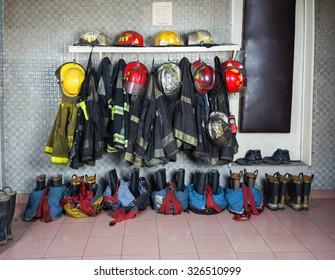 Firefighter suits and gear arranged at fire station