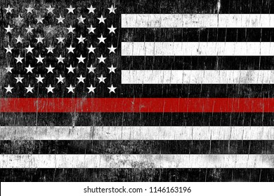 A firefighter support flag painted over a cracking wooden texture.