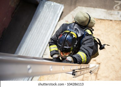 Firefighter in training climb with the fire stairs