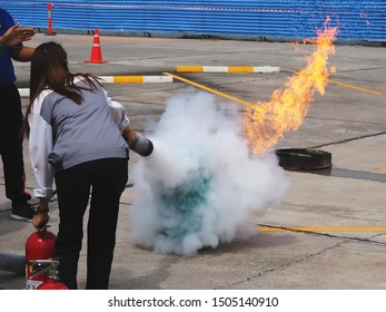 Firefighter training, The Employees Annual training Fire fighting and Fire extinguisher training, back view of people use extinguisher