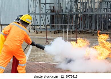 Firefighter training ,Fireman .firefighters spray water to fire