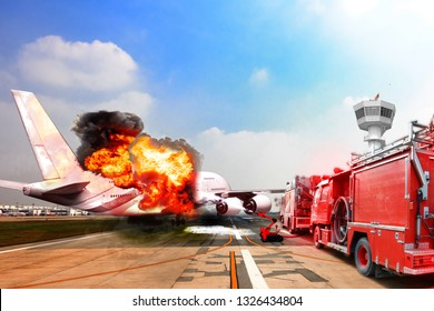 Firefighter truck and fire robot unit during battle fire on aircraft crashing with exploding engine on fire