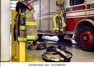 Firefighter truck and protection gear in firehouse