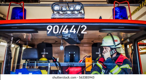 Firefighter used a walkie talkie in the fire truck - HDR