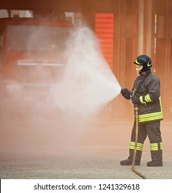 firefighter uses a powerful foam to extinguish a fire