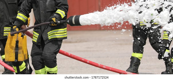 firefighter uses a powerful foaming agent to put out a fire