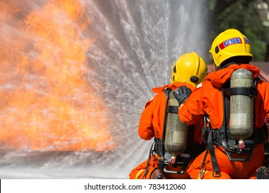 Firefighter are using water in fire fighting operation / Fire and rescue training school regularly to get ready.
