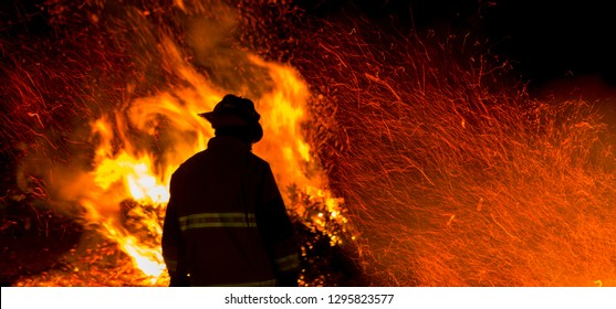 Firefighter watches a controlled burn