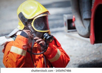 Firefighter wearing mask safety suite for fire fighting, fire safety concept