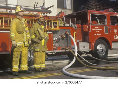 Firefighter working with fire hose, Los Angeles, California