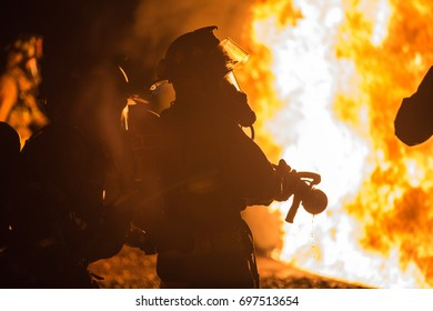 Firefighters Battle a Fire During Training.