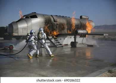 Firefighters battle plane fire in simulated training.