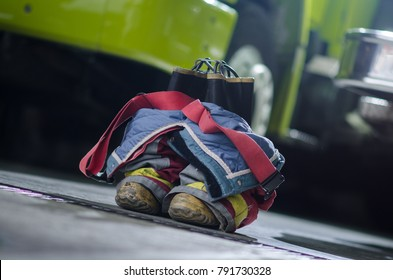 Firefighter's boots and trousers in a fire station.