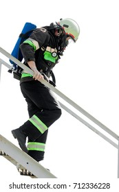 Firefighters climb down the fire ladder down the isolate, fireman climbs up the ladder during a training exercise in the firehouse