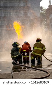 The Firefighters demonstrating fire fighting.
