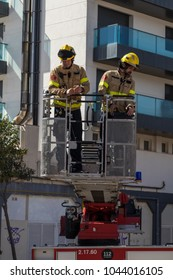 Firefighters exhibition on village Palamos. Rescue an injured person from a house with big crane. March 10, 2018 , Spain