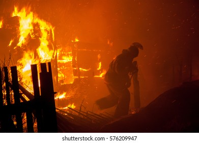 Firefighters extinguish a building