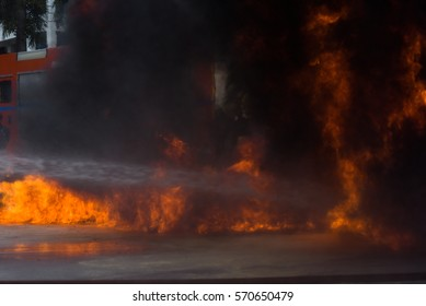 Firefighters extinguish a fire during a training exercise.