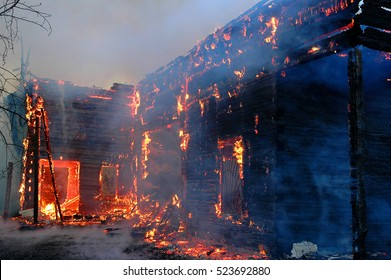 Firefighters extinguish a house