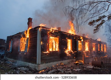 Firefighters extinguish a house and building