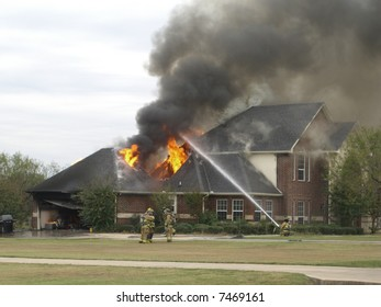 Firefighters extinguishing a house fire