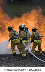 Firefighters fight a blaze