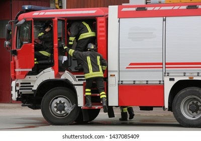 firefighters  and the fire engine during a fire drill