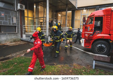 Firefighters, lifeguards and red cross rescue people from office building, Zrenjanin, Serbia February 28, 2020 regular firefighter drill