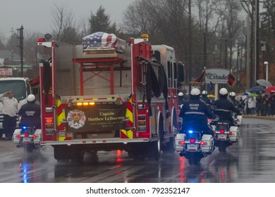 Firefighters line the route for the funeral procession of Philadelphia firefighter Captain Matthew LeTourneau, who died January six days earlir in the line of duty, Friday, January 12, 2018.