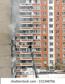 Firefighters on hose attack the fire in apartment building