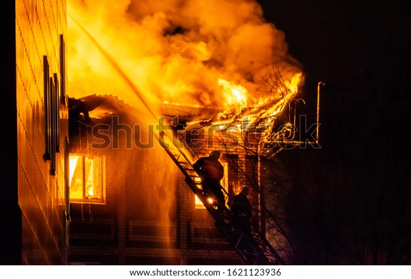 firefighters-on-ladder-extinguish-burnin