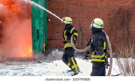 firefighters operation. spray water to wildfire