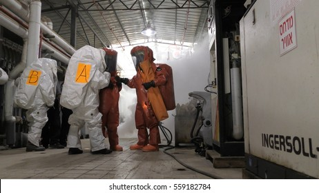 Firefighters practice sealing of leak accident from corrosive toxic hazardous material Ammonia liquid container in fruit factory dressing protective suites, Yesud Hamaala, Israel, March 21, 2016.