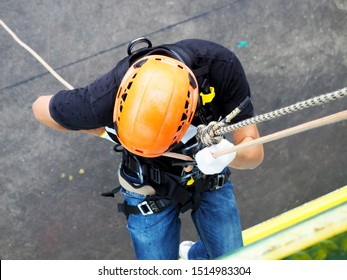 Firefighters are rappelling and climbing ropes at a drill exercise