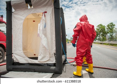 firefighters in red chemical suit