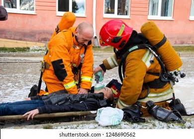 Firefighters rescue children from school. Belarus/Oshmyany/25 November 2018. Practicing the actions of rescuers during a fire. Evacuation of children. Artificial respiration for a child