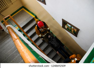 Firefighters rescue children from school. Belarus/Oshmyany/25 November 2018. Practicing the actions of rescuers during a fire. Evacuation of children