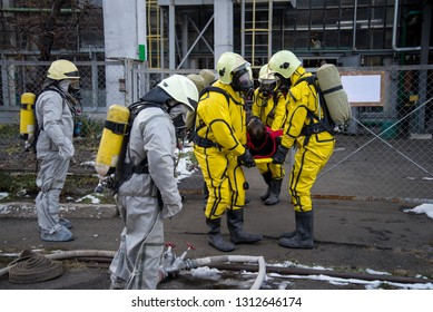 Firefighters and rescuers in a radiation protection, chemical protection suit  rescue the injured.