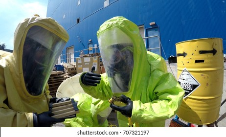 Firefighters seal leak of hazardous corrosive toxic materials from barrels after rocket attack during drill called Northern Face, MIGDAL HAEMEK, ISRAEL, MARCH 23, 2015.