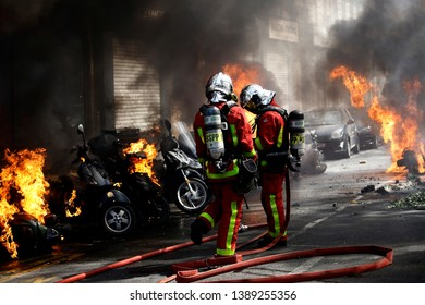 Firefighters spray water on burning scooters on a street during a demonstration called by the Yellow vest  movement against the policy of Emmanuel Macron  in Paris, France on Apr. 20, 2019