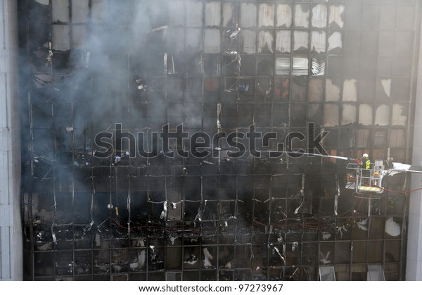 Firefighters Tackle a Blaze at an Office Block